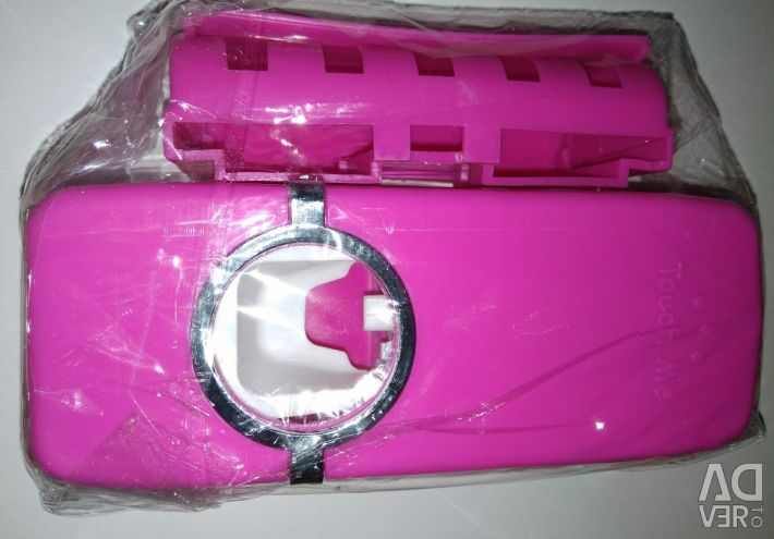 Toothbrush holder with dispenser