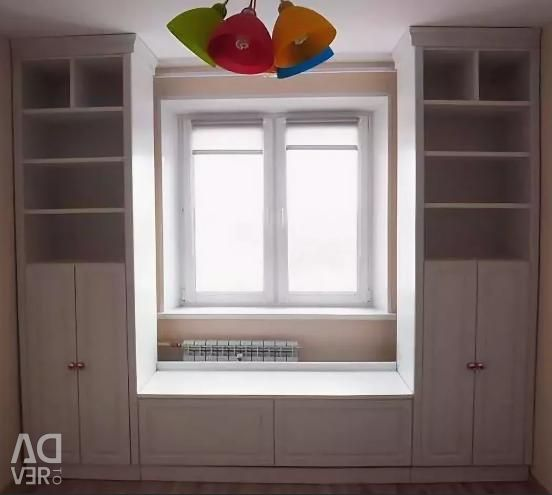 Built-in wardrobe around the window to order