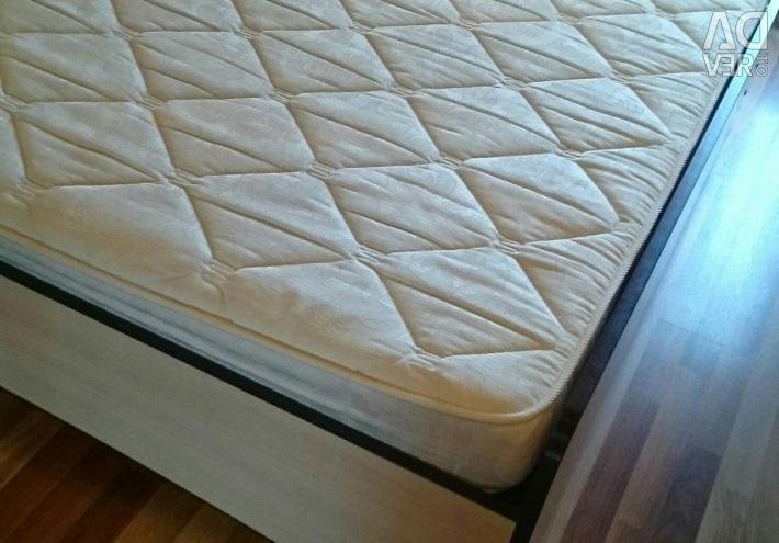 Bed with mattress.