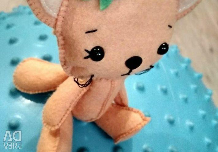 Kitten from felt. Interior toy.