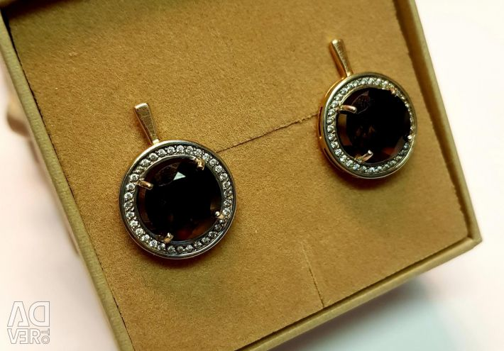 Earrings with topaz. 585 gold sample