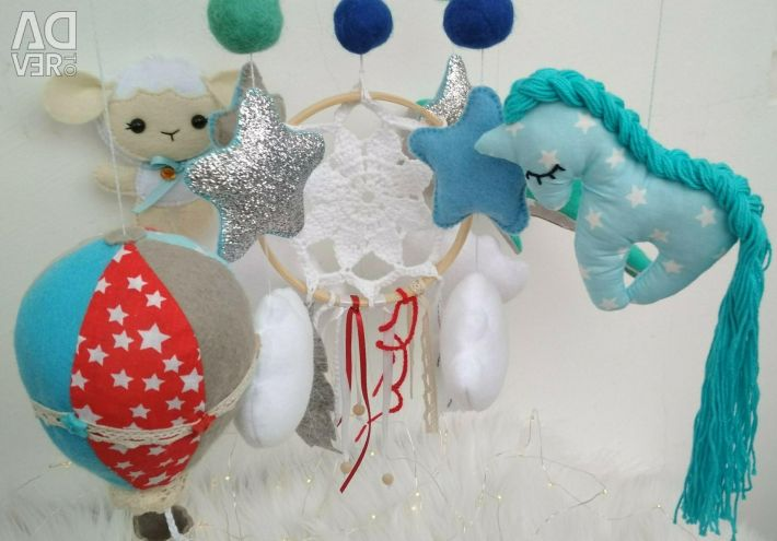 Mobile in a cot out of felt, handmade