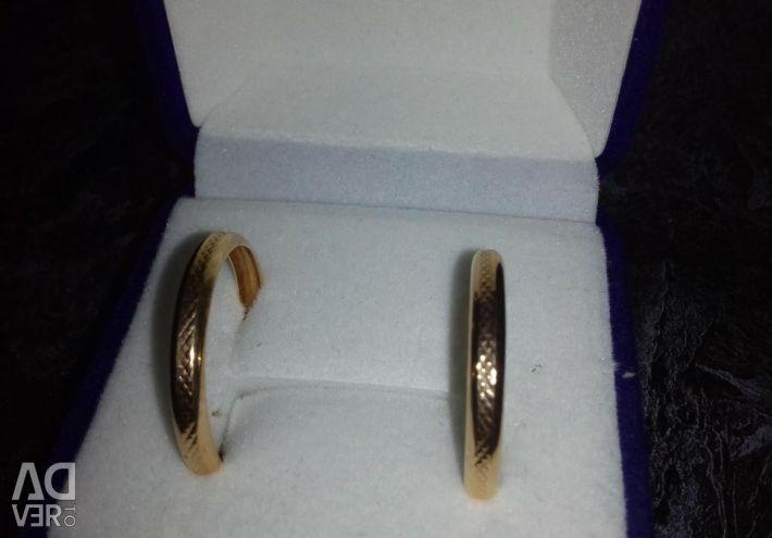 Gold ring earrings.