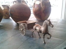 Bronze horse with a wagon