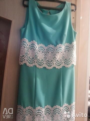Turquoise dress with a circle
