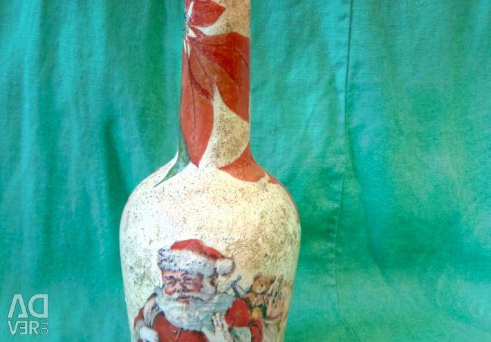 Bottle of decoupage Santa Claus