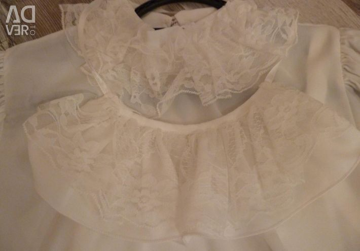 Very elegant white blouse with ruffles