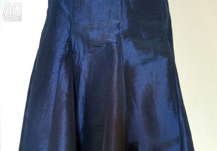 The skirt is evening, fabric metallic