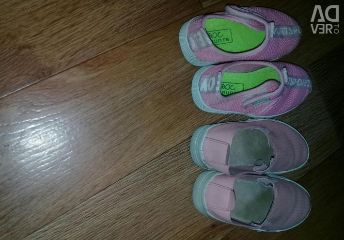 Two pairs of shoes on a girl