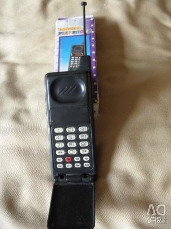 Телефон іграшка