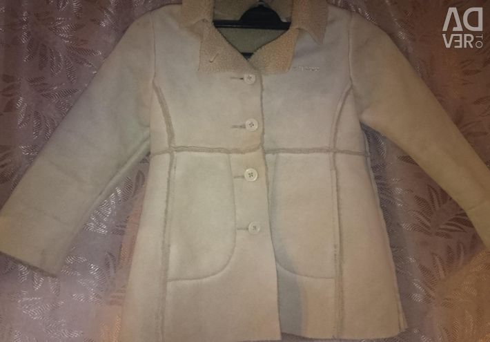 Suit and sheepskin coat
