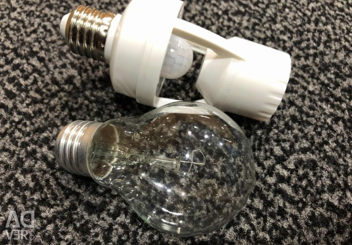 Lamp with motion and light sensor
