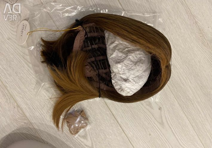 New synthetic wig. Length 30 cm