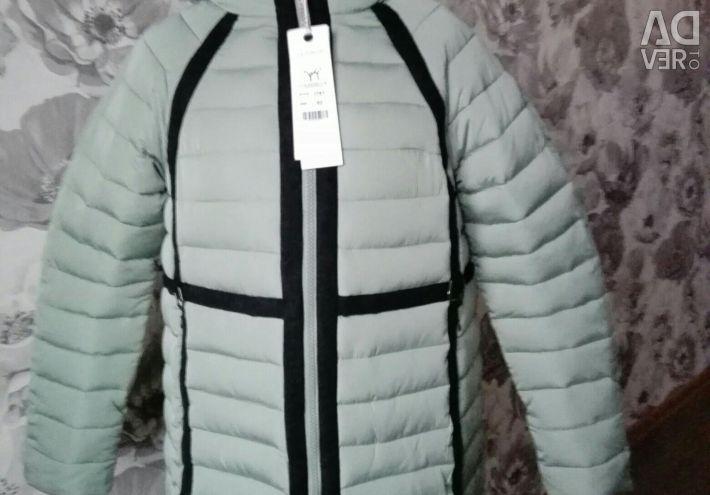 Пальто фисташкового цвета