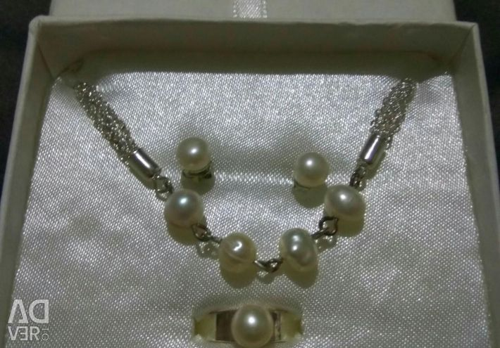 Set with natural pearls.
