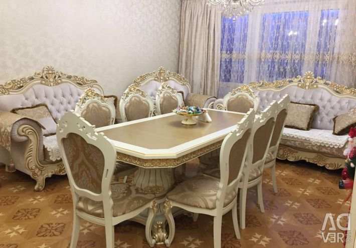 Table, chairs, display cases, upholstered furniture