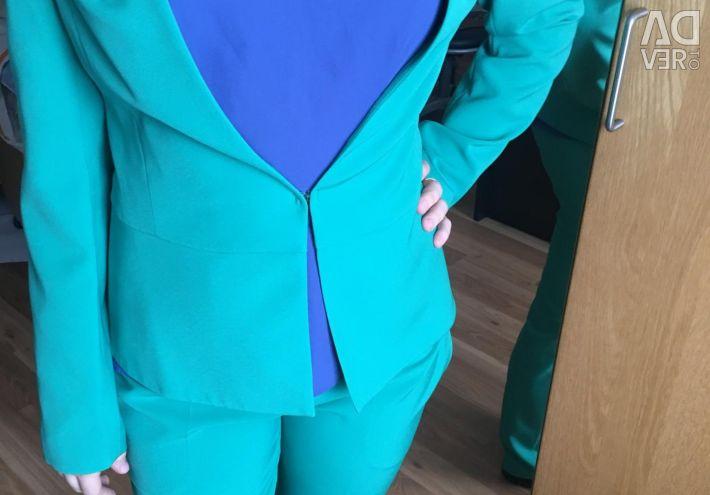 Jacket + trousers + blouse. Business suit (troika).