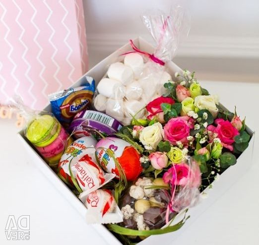 Bouquets of flowers, sweets and toys.