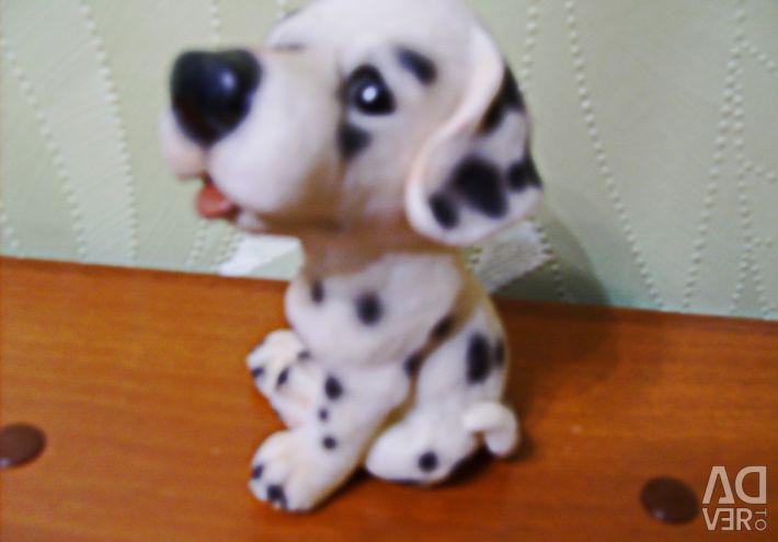 Figurină de cățeluș din ceramică.