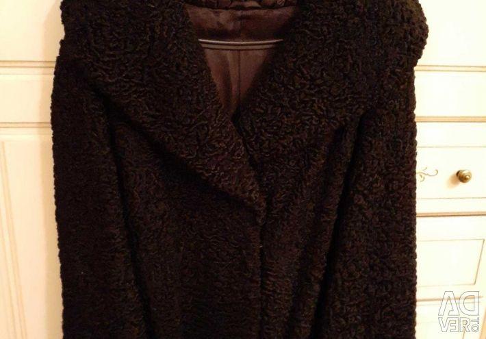 Fur coat of astrakhan fur. New.