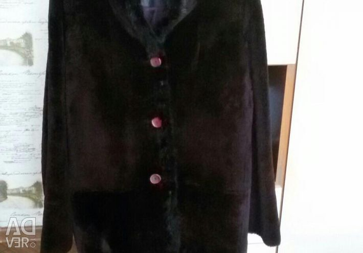 Female short fur coat from the facilitated muton