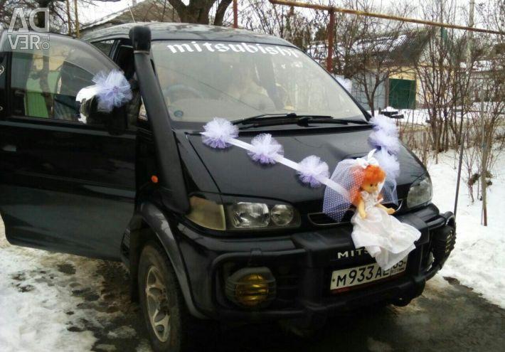 Decoration for a wedding car on a minivan
