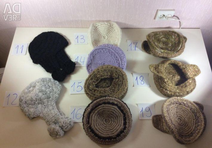 Тeплые шерстяные ушанки, кубанки, шляпки и шапки