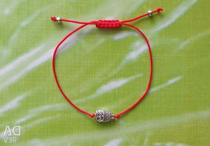 Thread amulet against the evil eye