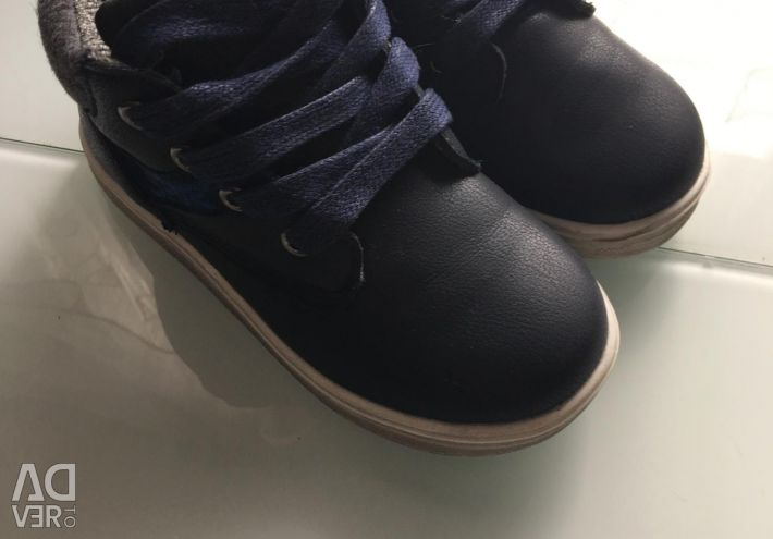 Selling shoes for a boy.