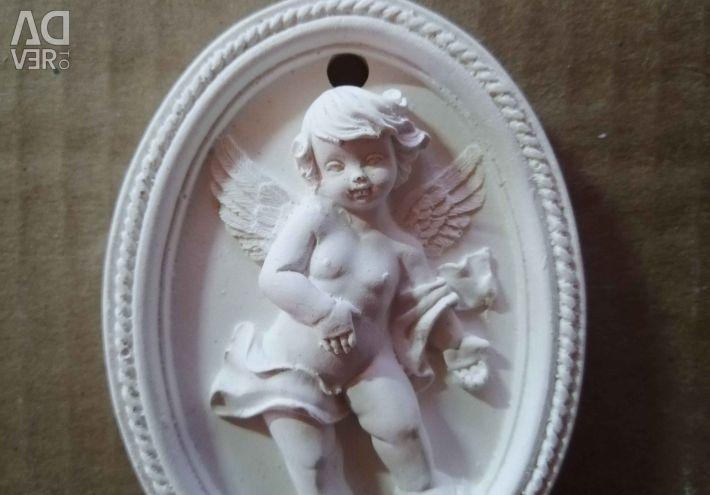 Wall plaster angel
