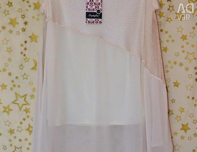 New blouse-tunic of cream color