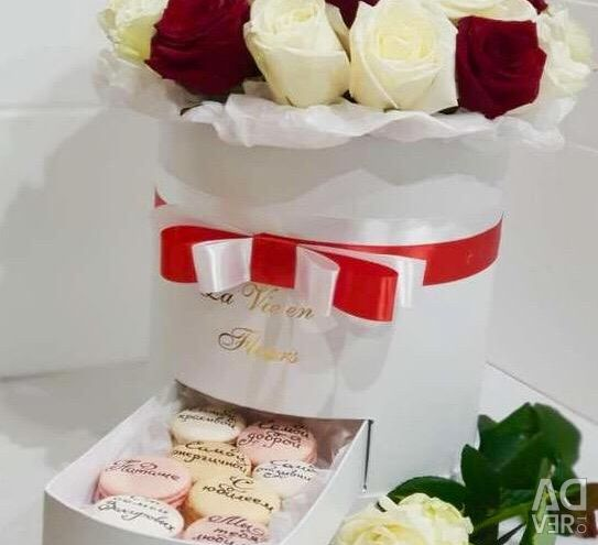 Roses in the box. Gift box with macaroons.