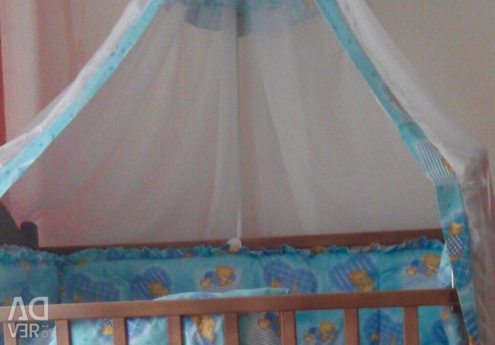 Crib in the crib and canopy.