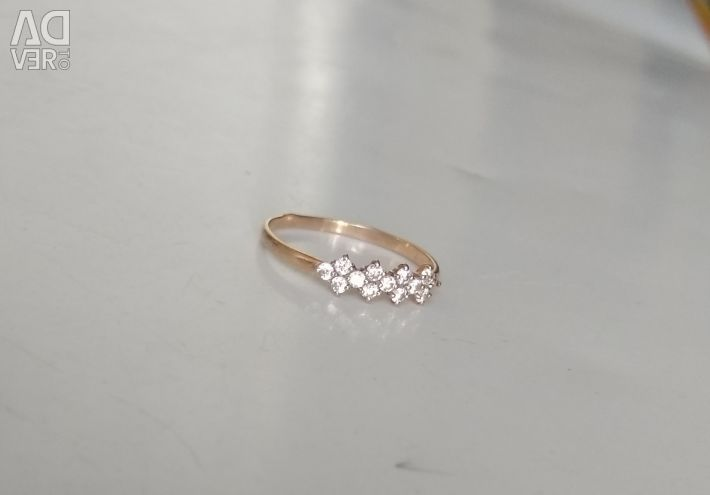 Red gold ring with cubic zirkonia
