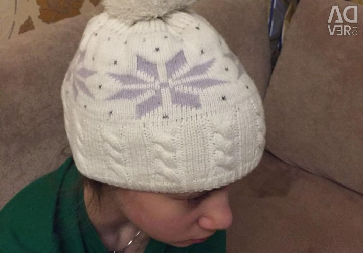 The cap is warm on a fleece lining. For 7-10 years