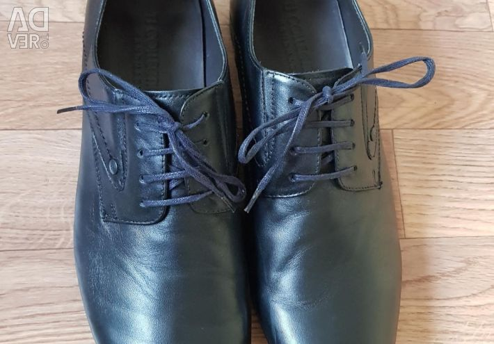 Leather branded shoes.