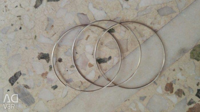 Metallic golden hoops. They have never been worn. Includes