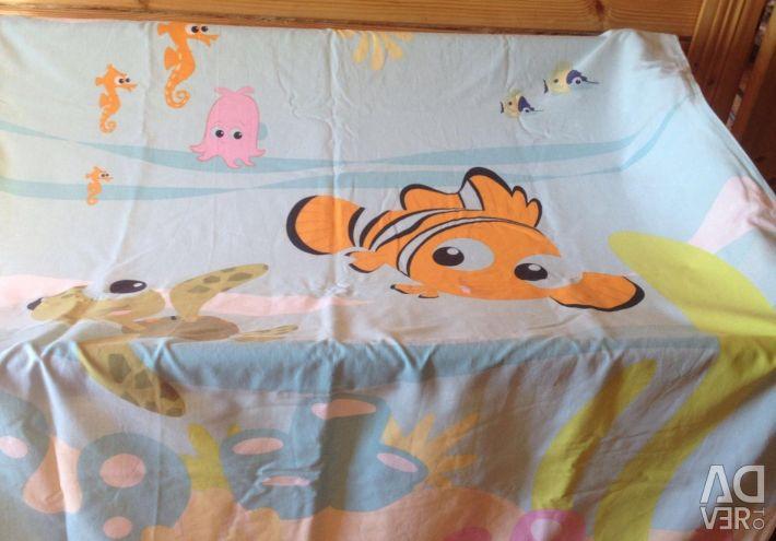 Cot + mattress + mattress + bedding.