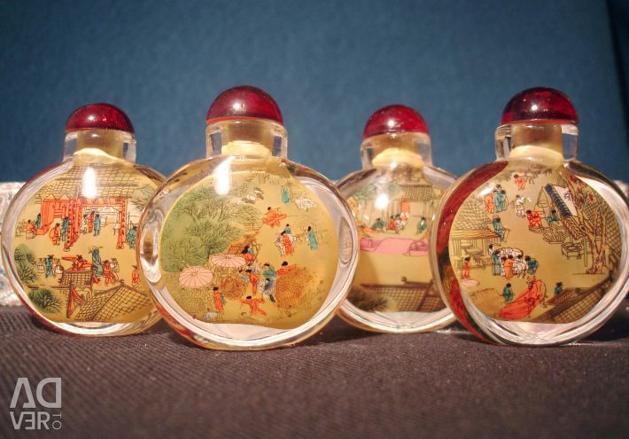 A set of vials with a painting from the inside. On the river