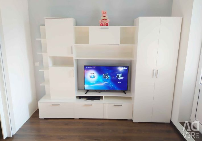 Wall slide with a cupboard and a niche for TV