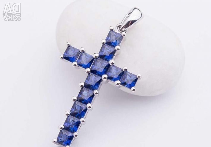 Golden cross with blue sapphires