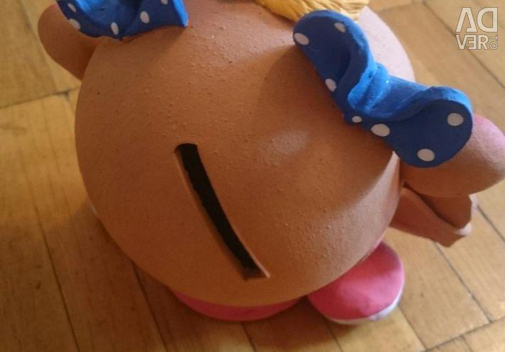 Piggy bank is cheerful
