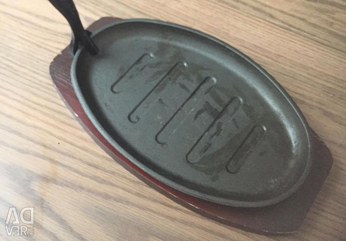 Set of 4 cast iron pans with stands