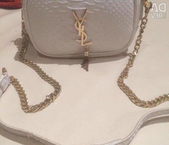 Women's handbag is white. Brand.