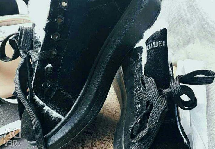 Sneakers on fur, winter