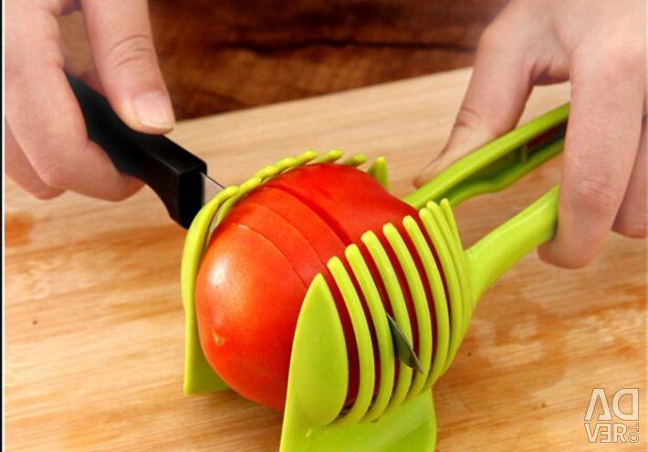 Ο κάτοχος για την κοπή λαχανικών και φρούτων