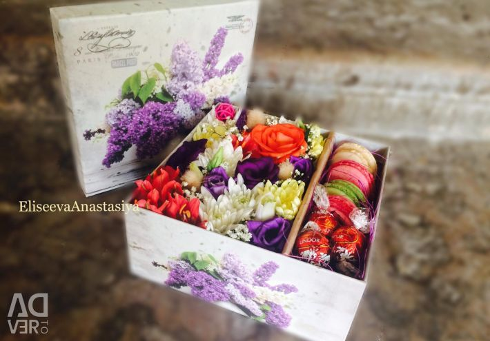 Fresh flowers in a box with sweets