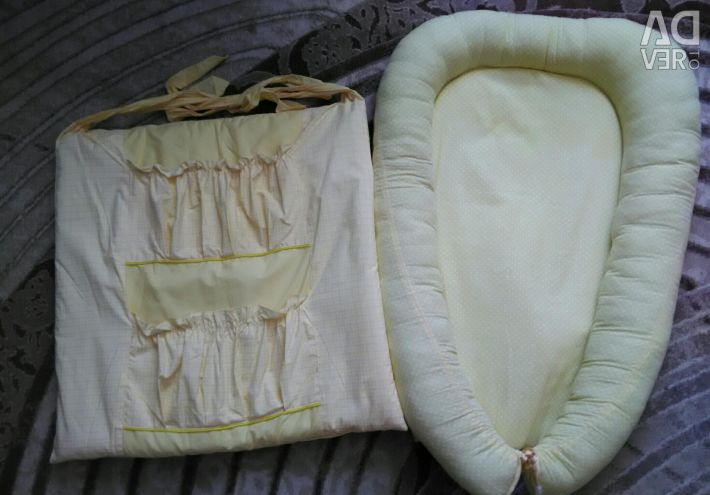 Cocoon (nest) and pocket on the crib