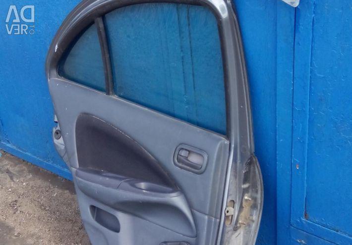 Rear left door Nissan Almera Classic N16 2005