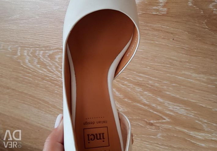 Shoes are white natural.